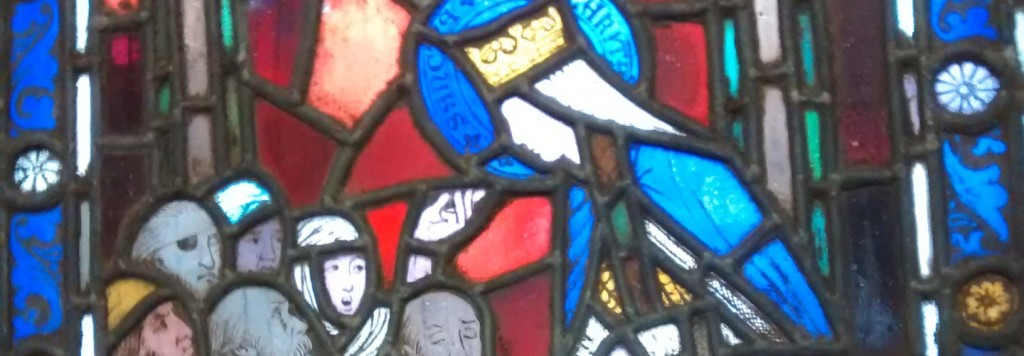 stain glass window of Mary teacing